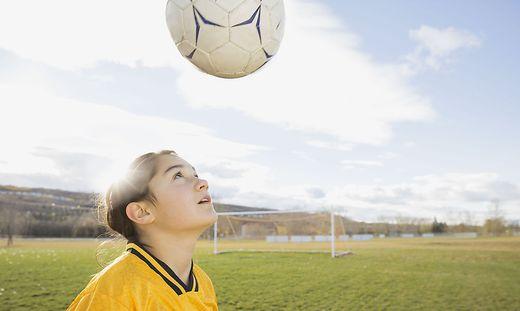 Soccer player juggling soccer ball