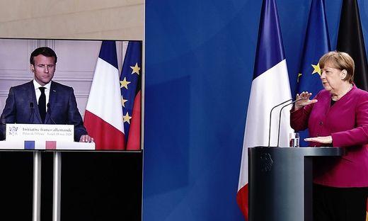 Frankreichs Präsident Macron war bei der Präsentation von Merkel zugeschalten