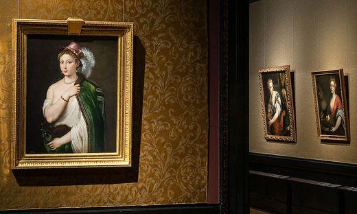 """Ausstellungsansicht: """"Junge Frau mit Federhut"""" (1534/36) von Tizian"""