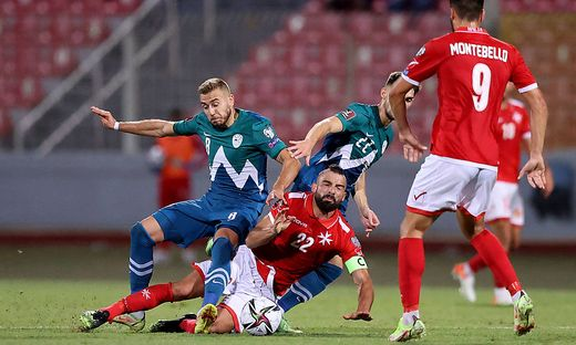 Malta�s Zach Muscat (C) is fouled during the European Qualifying soccer match for 2022 World Cup between Malta and Slov