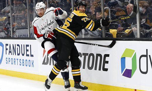 BOSTON, MA - MAY 19: Boston Bruins defenseman Connor Clifton (75) hits Washington Capitals winger Michael Raffl (17) du