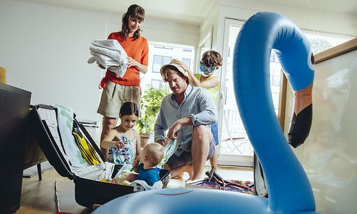 Family of five packing for holiday trip